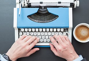 Author Typing on Typewriter